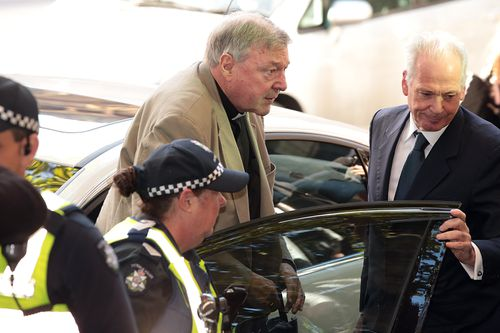 Pell arrives to court in a car, instead of the usual walk from his lawyers office. (9NEWS)