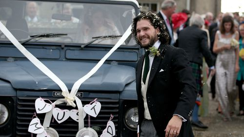 Harington, wearing a morning suit, and Leslie, in a flowing ivory gown and veil, smiled at members of the public who had gathered outside the church. Picture: PA
