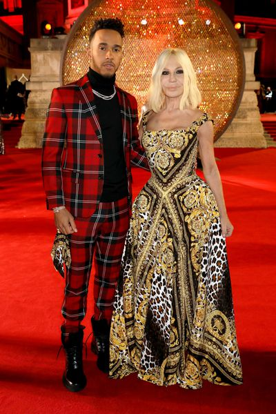 Lewis Hamilton and Donatella Versace in Versace at the Fashion Awards, London.