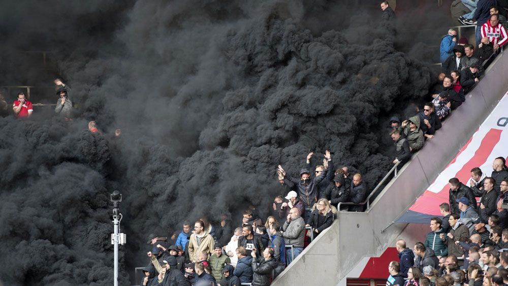 PSV Eindhoven supporters detonate smoke bombs against Ajax in Eredivisie
