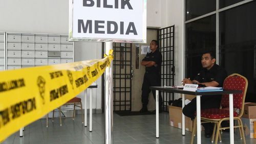 Malaysian police officers guard outside the media room of Shah Alam court house in Shah Alam, outside Kuala Lumpur. (AP)