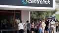 Newly unemployed Sydneysiders queue up outside a Centrelink in Rockdale. (Janie Barrett/The Sydney Morning Herald)