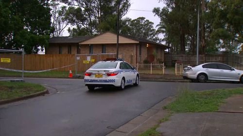 A crime scene was set up as police canvassed the street. (9NEWS)