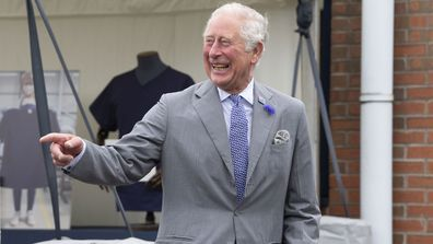 Prince Charles, Prince of Wales laughs during a visit with Camilla, Duchess of Cornwall to the Turnbull & Asser shirt factory on July 9, 2020 in Gloucester, United Kingdom