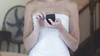 Bride texting on phone