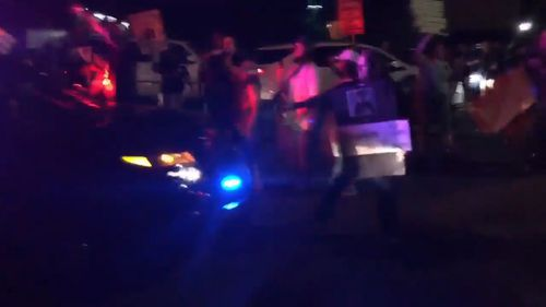 A protester demonstrating against the police shooting of Stephon Clark was hit by a police car last night, sparking violence after weeks of tension. Picture: Supplied.