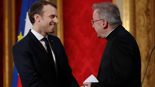 A file photograph shows French President Emmanuel Macron greeting Luigi Ventura in France.