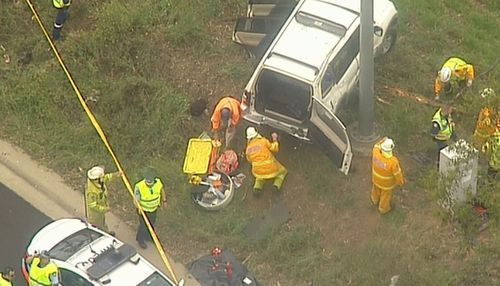 Police were called to the M7 at Cecil Hills in the city's southwest after the vehicle rolled after 9am.