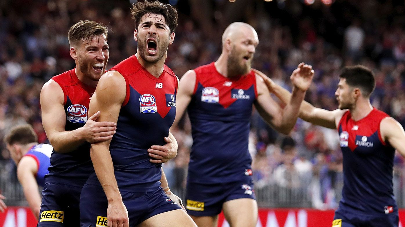 Melbourne completes revival from being AFL's 'laughing stock' to claim premiership glory