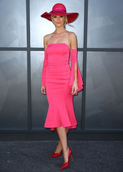 Model Brooke Hogan in a Forever New dress andGianvito Rossi heels