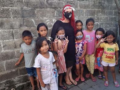 Let's Help Bali founder Amanda with some of the children she has helped