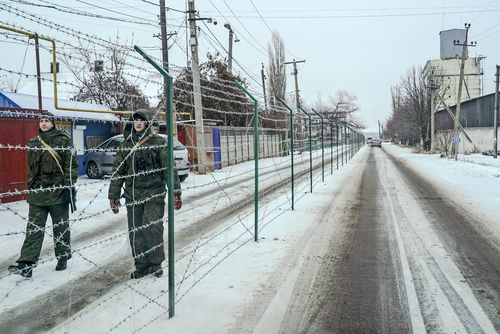 The fence was built by Russia earlier this year, preventing residents from routinely crossing the street to speak to neighbours.