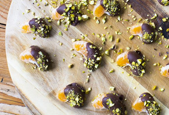 Pistachio and dark chocolate dipped mandarin