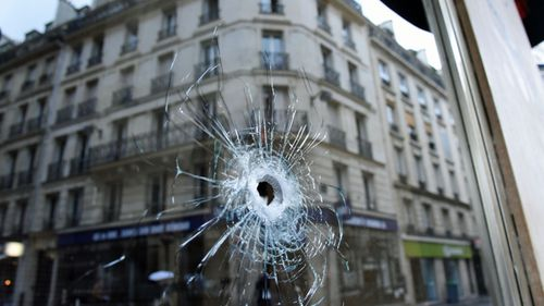 A bullet hole seen on the window of a cafe located near the area where the assailant of a knife attack was shot dead by police officers. (AP).
