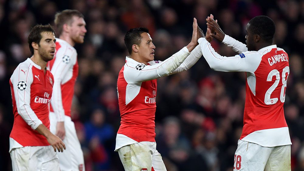 Arsenal's Alexis Sanchez (centre) celebrates a goal with teammates. (AAP)