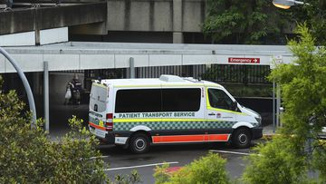 A patient transport service vehicle parked at the main entrance at Westmead Hospital, Westmead, NSW.