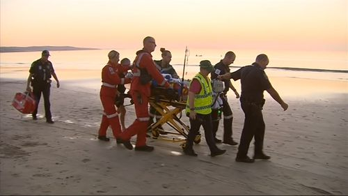 An off-duty paramedic tended to the woman after she was pulled from the water.
