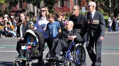 Veterans march towards the Shrine of Remembrance with young generations during the Anzac Day. (AAP)