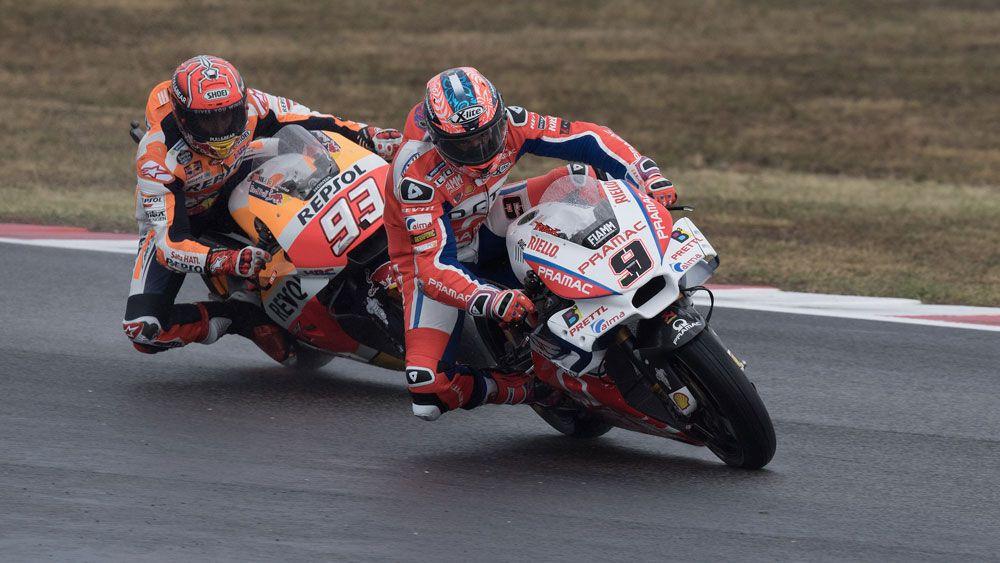 Marc Marquez passes Danilo Petrucci on final lap to win rainy San Marino MotoGP