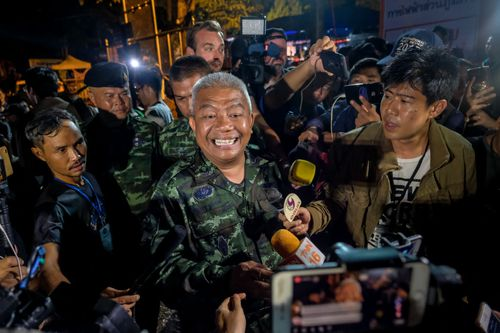 General Bancha Duriyaphan speaks to the press after confirming the team had been rescued. Picture: Getty