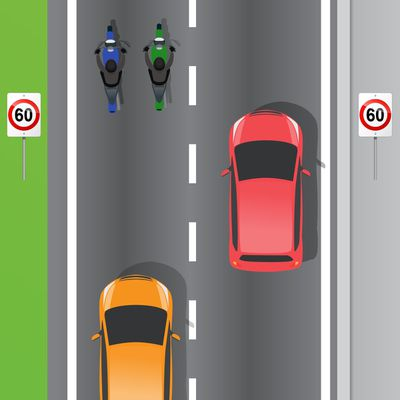 Can motorcyclists ride side-by-side?