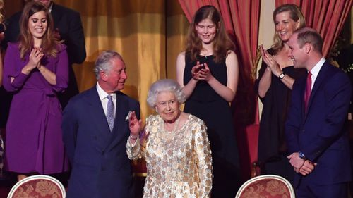 Queen Elizabeth II, surrounded by members of the royal family, takes her seat at the Royal Albert Hall in London. (PA)