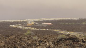Vehicles are backed up on Waikoloa Road after a mandatory evacuation was ordered as a wildfire approached the Waikoloa Village.