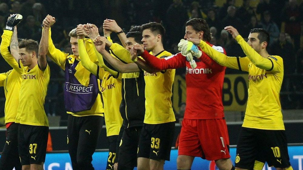 Borussia Dortmund players celebrate after the fulltime whistle. (AAP)