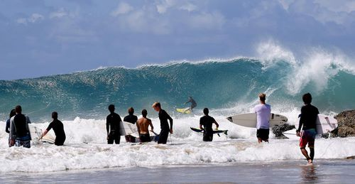 Surfers are seen at Snapper Rocks on the Gold Coast.