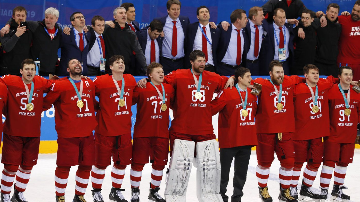 Russian ice hockey players sing banned national anthem after gold medal win over Germany