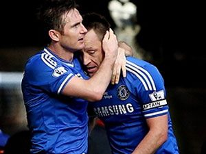 John Terry (R) is congratulated by Frank Lampard after scoring. (Getty)