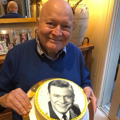 Patti Newton gives her husband Bert Newton a cake on his 82nd birthday.