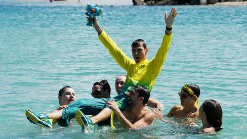 Bird-Smith is held up by his friends after winning gold. (AAP)