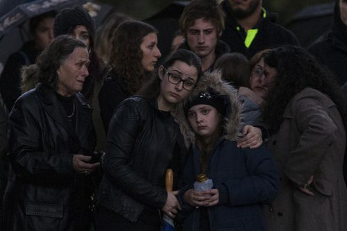 Mourners gather for the Vigil for slain homeless woman Courtney Herron, at Royal Park in Melbourne, Friday, May 31, 2019.