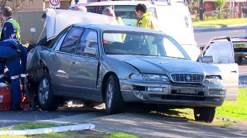 Sydney two-vehicle crash results in couple being hit by their own car