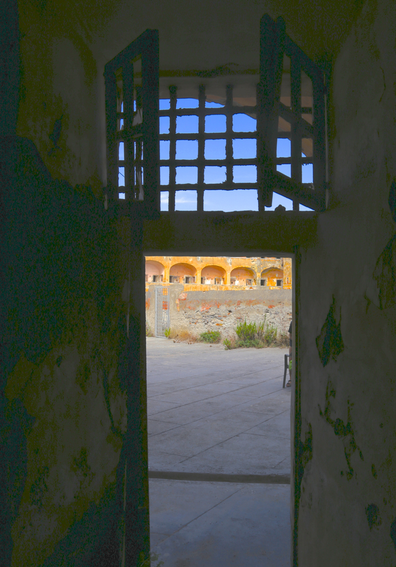 The building was constructed as a jail in the 18th century. The cells in Santo Stefano prison have decayed over centuries