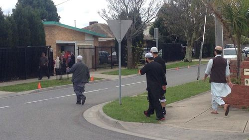 Family and friends arrive for Numan Haider's funeral. (9News)