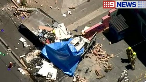 The area around the crash site is littered with debris. (9NEWS)