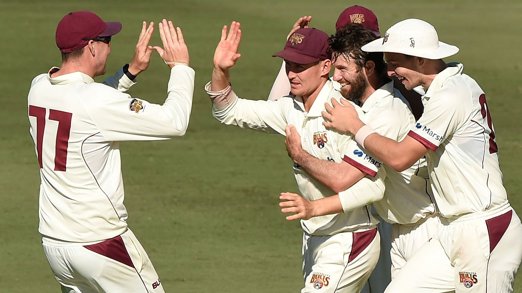 Queensland players celebrate a screamer of a catch from Marnus Labuschagne.