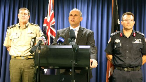 NT Chief Minister Adam Giles (centre), flanked by Corrections Commissioner Mark Payne (left) and Police Commissioner Reece Kershaw. (AAP)