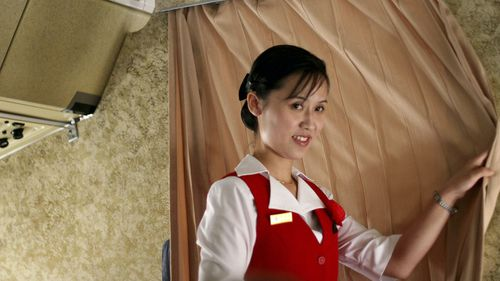 A cabin crew member on Air Koryo, which flies limited routes and is also the country's air force