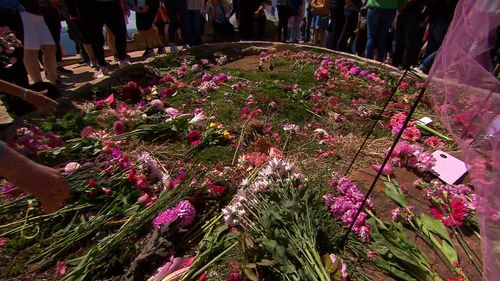 Friends and family laid flowers and wore pink  - Lyn's favourite colour.