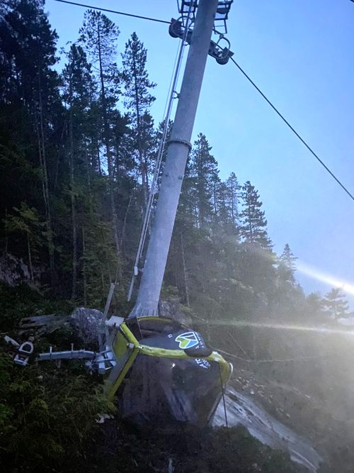 A car from the Sea-to-Sky Gondola lies crumpled on the ground after the cable was cut on Monday (local time).