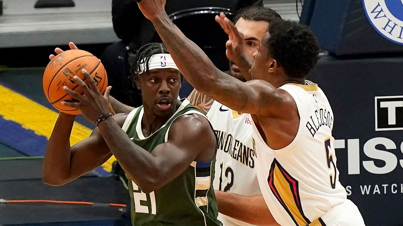 NBA star Jrue Holiday pledges to donate entire $25m salary to small businesses