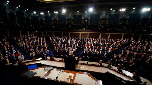 Republicans were boisterous during Mr Trump's address, often rising to cheer, while Democrats were subdued. (AAP)