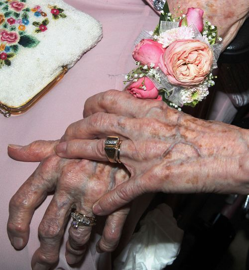 "Vivian Boyack and Alice ""Nonie"" Dubes grasp hands on their wedding day in Davenport, Iowa. (AP Photo/The Quad City Times, Thomas Geyer)"