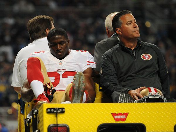 Reggie Bush is carted off the field after suffering an injury. (AFP)