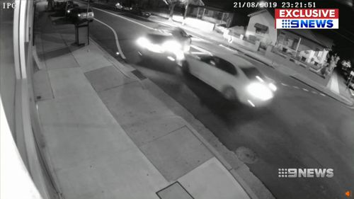 Security vision obtained by 9News shows a white sedan ram an SUV packed with five people until it spins out on Cumberland Road in Auburn last night.