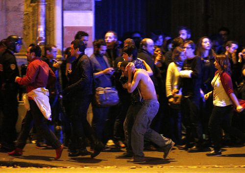 Wounded people are evacuated outside the scene of a hostage situation at the Bataclan theatre in Paris, France, 14 November 2015. Dozens of people have been killed in a series of attacks in the French capital Paris