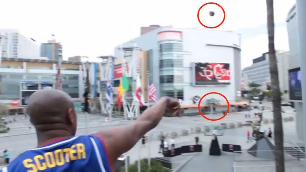 Harlem Globetrotter nails 30m balcony shot